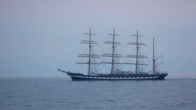 beautiful sailing ship in the evening sea video