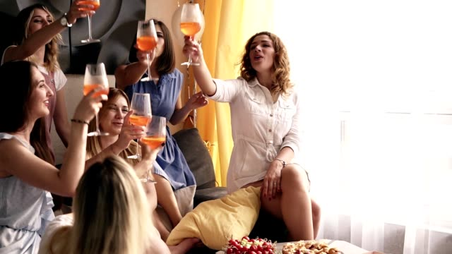 beautiful scene of a girlfriends having fun time together. celebrating, drinking alcohol cocktails with bridesmaid. shouting and clinking the glasses. fancy interior. slow motion - bachelorette party stock videos and b-roll footage