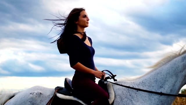 beautiful scene of natural beauty riding a horse in slow motion - rancher video stock e b–roll