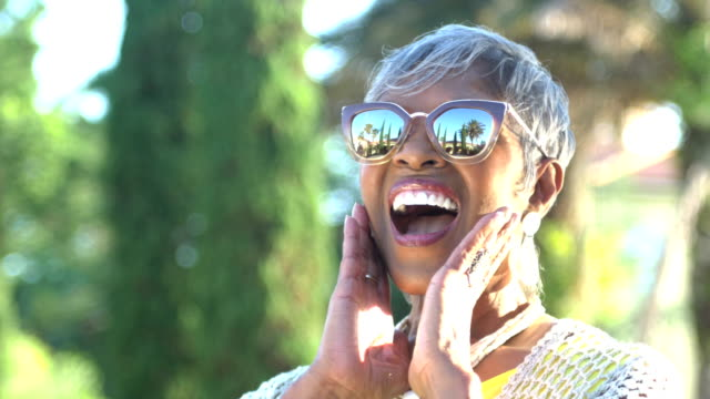 Beautiful senior African-American woman with sunglasses