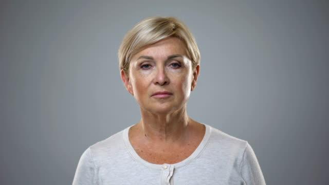 beautiful senior lady looking in camera, anti-aging cosmetics, skin care, beauty - collagene video stock e b–roll