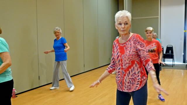 Beautiful senior woman have fun in dance class video