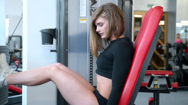 Beautiful sexy athletic young Caucasian girl working out training arms abs legs butt video