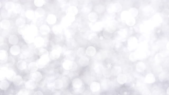 beautiful shiny gleam white bokeh christmas and new year background with snow falling - snowflake background stock videos & royalty-free footage