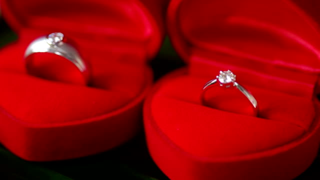 Beautiful shiny wedding rings with red boxes for bride and groom. Beautiful shiny wedding rings with red boxes for bride and groom. brushed metal stock videos & royalty-free footage