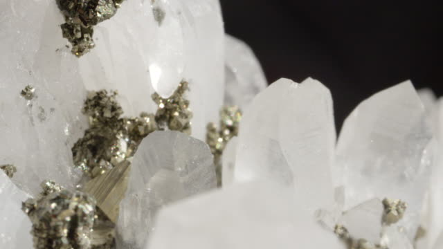 MACRO DOF: Beautiful shiny white quartz stone in combination with golden pyrite. video