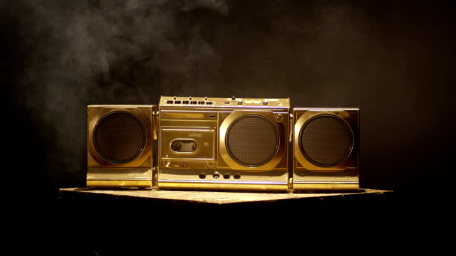 beautiful shot of a decorative and without trademark tape recorder on black background. shot on red helium cinema camera . - hip hop video stock e b–roll