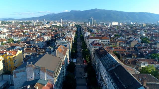 beautiful shot of a drone flying over main street in the downtown district in sofia, bulgaria - bułgaria filmów i materiałów b-roll