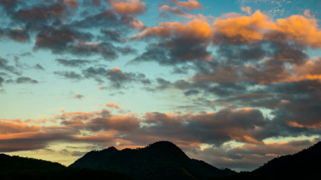 Beautiful silhuaette mountain and moving clouds at with dramatic sky video