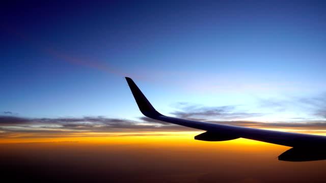 beautiful sky in the morning flying airplane flight with aircraft wing - skrzydło samolotu filmów i materiałów b-roll