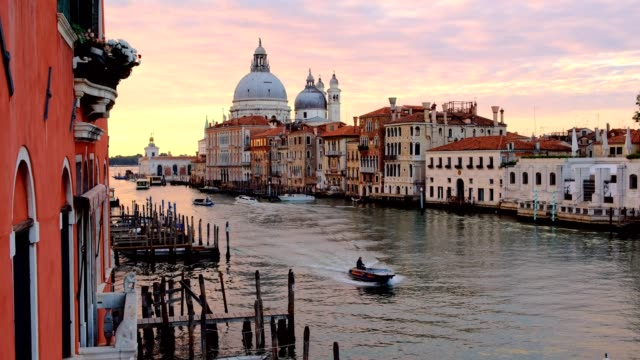 beautiful skyline sunrise in venice grand canal italy. view of basilica di santa maria della salute, cityscape venice - canale video stock e b–roll