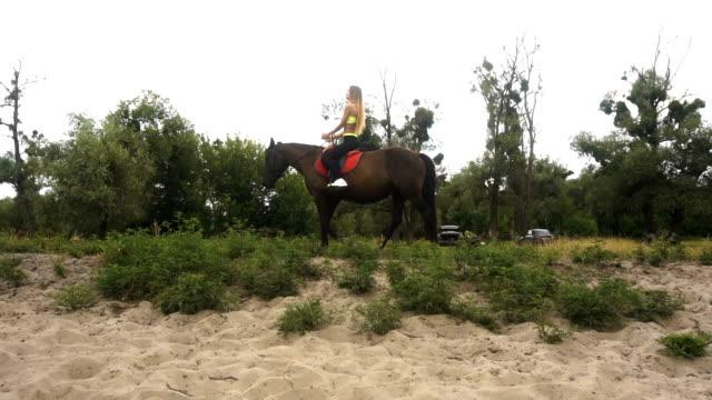 beautiful slender girl riding her horse video