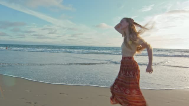 Beautiful slow motion of woman running by the ocean and smiling video