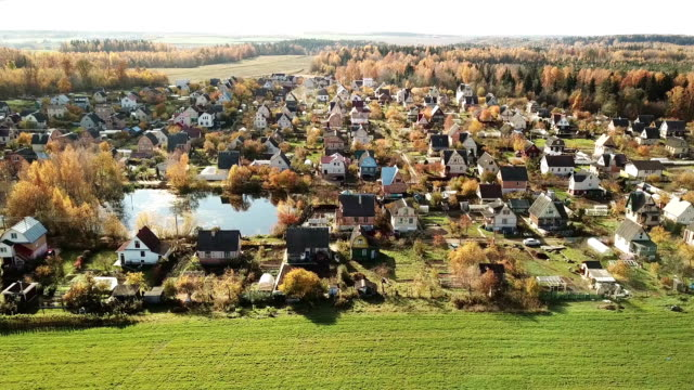 Beautiful small village in the autumn forest. video
