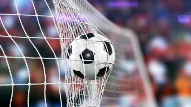 vídeos de stock e filmes b-roll de beautiful soccer slow motion concept of the ball flying into goal net. fans taking pictures with flashes. 3d animation close up sport concept. - comemoração conceito