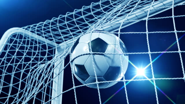 Beautiful Soccer Slow Motion Concept of the Ball flying into Goal Net. Fans taking pictures with flashes. 3d animation Close up of the Goal Moment.