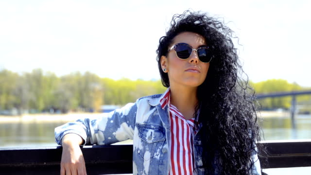 Beautiful stylish brunette takes off her sunglasses video