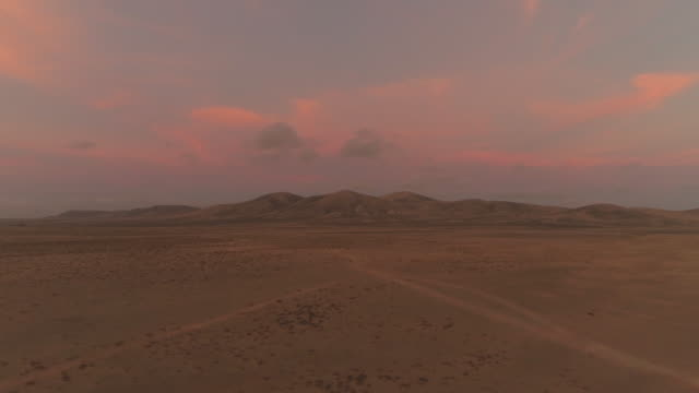 AERIAL: Beautiful summer sunset in lonely volcanic landscape in the Canaries. video