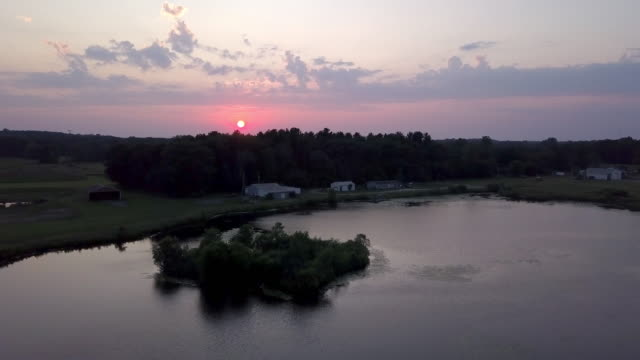 Beautiful Summertime Sunset Aerial footage of the Michigan Farm Land