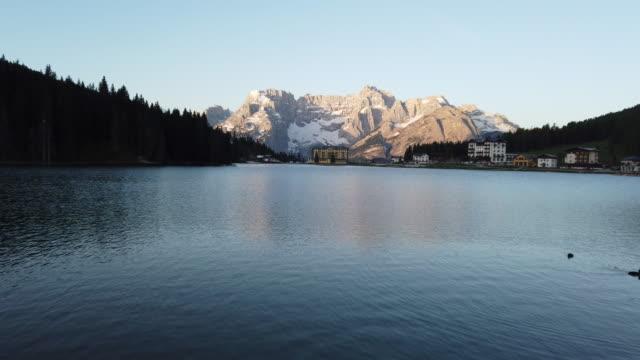 Beautiful sunrise at lake misurina with Dolomites mountain in background, Italy