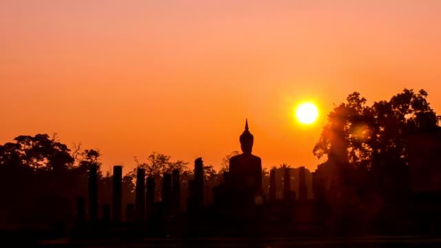 Beautiful sunrise at unrise sky at Sukhothai Historical Park, a UNESCO world heritage site, Thailand Beautiful sunrise at unrise sky at Sukhothai Historical Park, a UNESCO world heritage site, Thailand sukhothai stock videos & royalty-free footage