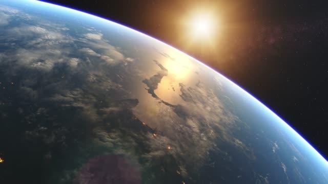 красивый восход солнца над землей из космоса - восход солнца стоковые видео и кадры b-roll