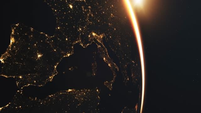 красивый восход солнца над европой из космоса - континент географический объект стоковые видео и кадры b-roll