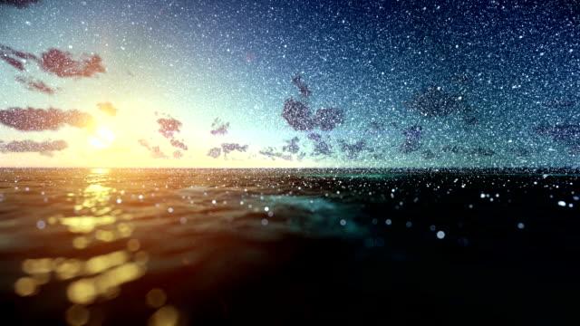 Beautiful sunrise over ocean, snowing, tilt video