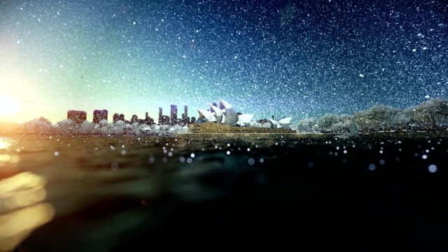 Beautiful sunrise over Sydney Opera House, snowing, dolly shot video