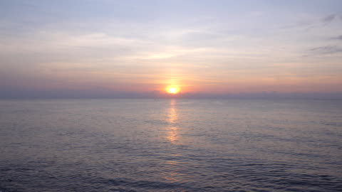 Beautiful sunrise over the sea Video of Beautiful sunrise over the sea. 4K(UHD) 3840x2160 format. horizon stock videos & royalty-free footage