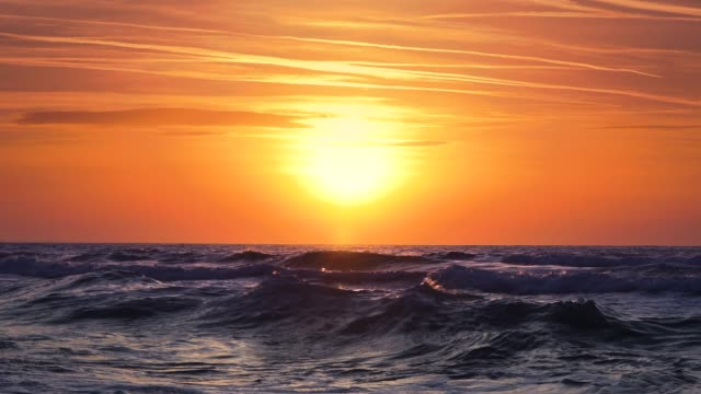 beautiful sunrise over the sea water video - gulf coast states stock videos & royalty-free footage