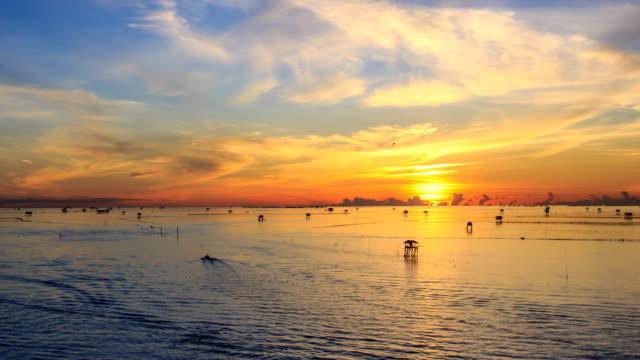 Beautiful Sunrise Sky On Sea Scape And Fishing Boat Sailing 4K Time Lapse video