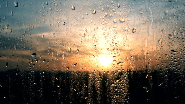 Beautiful sunrise while raining. Watching the sunrise behind the window. 4K Beautiful sunrise while raining. Watching the sunrise behind the window in 4K resolution condensation stock videos & royalty-free footage