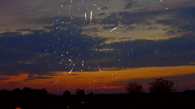 Video Beautiful sunset and colorful highlights fireworks after sunset Salute is in the sky