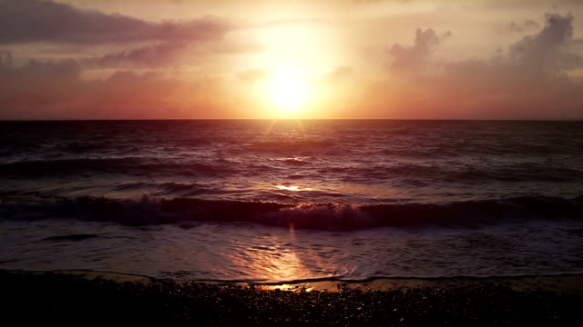 Beautiful sunset at the beach in superslowmotion video