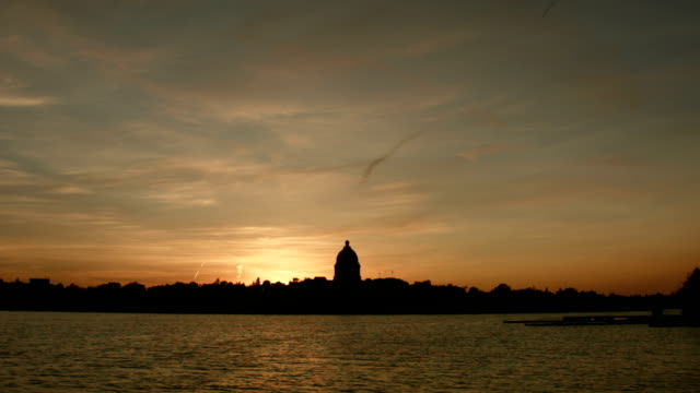 Beautiful sunset at the lake by a government building video