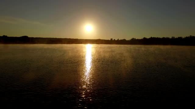 beautiful sunset over lake - aerial shot. - summer background filmów i materiałów b-roll