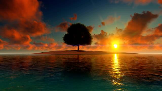 Beautiful sunset over sea and island with single tree