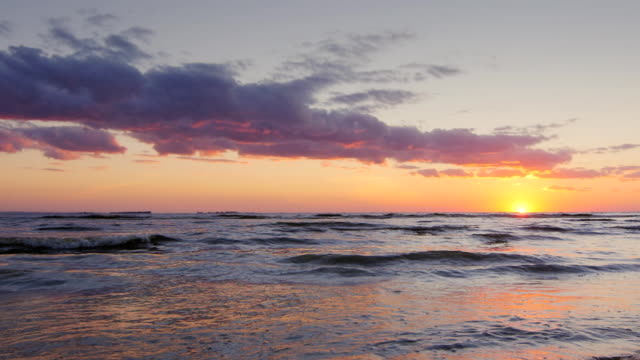 Beautiful sunset over the sea. Slow motion video video