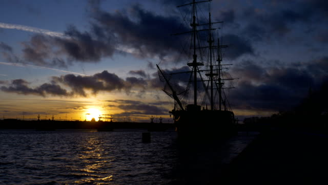 Beautiful sunset with a sailboat at the pier of St. Petersburg. video
