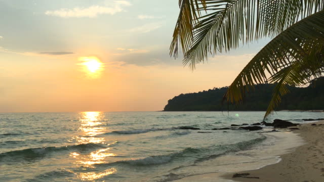 Beautiful sunset with beach and sea on island