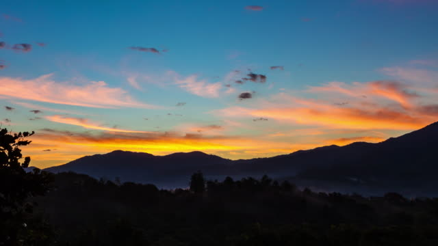 Beautiful sunshine with misty in the morning mountains at Chiang rai, north thailand, timelapse. video