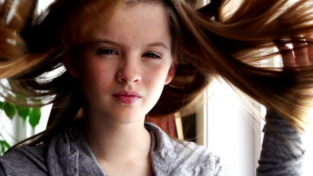 Beautiful teenager smiling at camera video