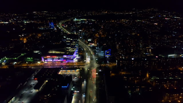 Beautiful time lapse aerial drone shot of city central district at night video