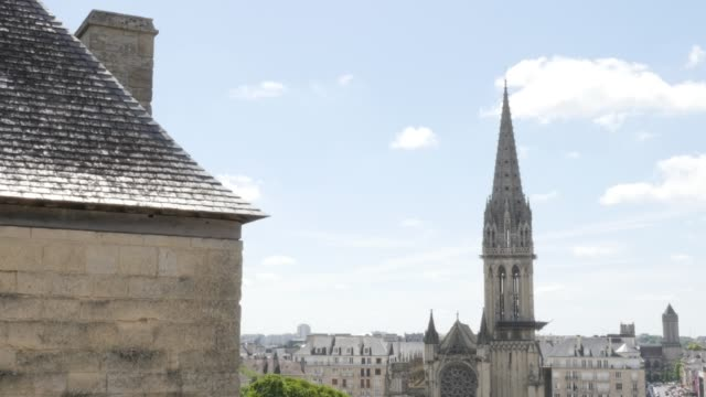 Beautiful tower of church Saint-Pierre located in Lower Normandy city of Caen by the day 4K 3840X2160 UltraHD footage - Saint-Pierre cathedral by the day slow tilt 4K 2160p UHD video Beautiful tower of church Saint-Pierre located in Lower Normandy city of Caen by the day 4K 3840X2160 UltraHD footage - Saint-Pierre cathedral by the day slow tilt 4K 2160p UHD video caen stock videos & royalty-free footage
