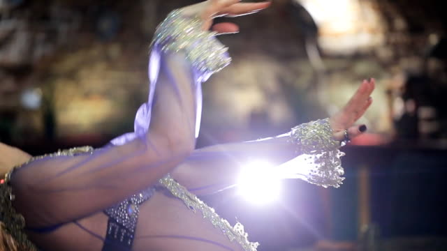 beautiful traditional female dancer dances belly dancing in restaurant - belly dancing stock videos and b-roll footage