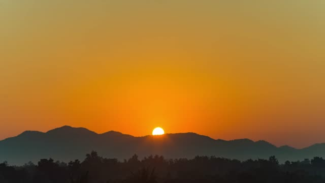 Beautiful Transform Shading Sky at Sunrise with Silhouette Mountain, Time Lapse Video