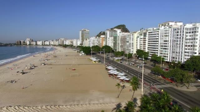 beautiful tropical beach landscape, luxury buildings in copacabana beach. - проспект стоковые видео и кадры b-roll