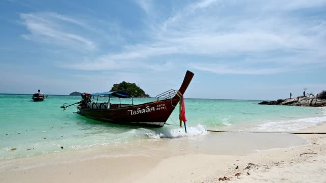 Beautiful tropical sea with wooden long-tail boat on the white beach at lipe island
