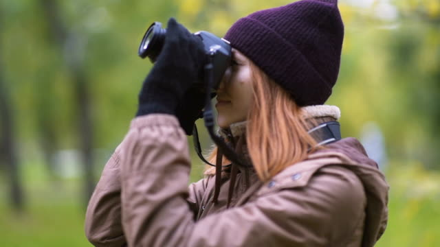 beautiful twoman tourist travel photographer photographing forest at autumn day video
